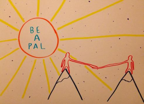 """A drawing of two mountains and on top of each mountain is a simple human-like figure, they have long arms stretching across the gap between the mountains to hold each other's hand. There is a large sun in the corner of the drawing which has the words """"Be a Pal"""" written inside it."""