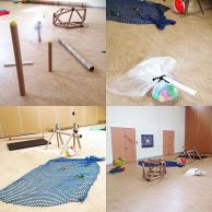 A montage of four photographs of a play space in a gym hall. The gym hall is filled with different structures and loose play items. The first shows large cardboard tubes standing on edge with colourful balls balanced on top. The second shows a bunch of colourful balls in a bag of bubble wrap attached to a cardboard tube. The third shows a close up of a blue net with balls trapped underneath. A beach ball and a cardboard tube structure are in the background. The fourth shows a long shot of the space. You can see all the various pieces and their positions in the hall.